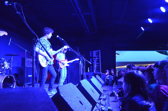 Surfer Blood performing in front of the audience at Paper Tiger's opening day. Photo by Alyssa Bunting.