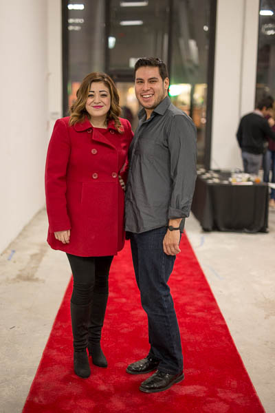 """Stephanie Guerra and Kristian Jaime pose for a photo on the red carpet at the """"Cocktail Culture: City on the Rise"""" premier. Photo by Scott Ball."""