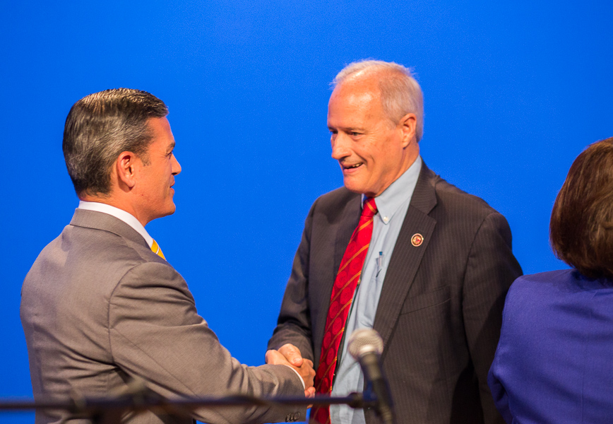Mayoral candidates Mike Villarreal and Tommy Adkisson shake hands before the mayoral forum hosted by Rick Casey at the KLRN-TV headquarters. Photo by Scott Ball.