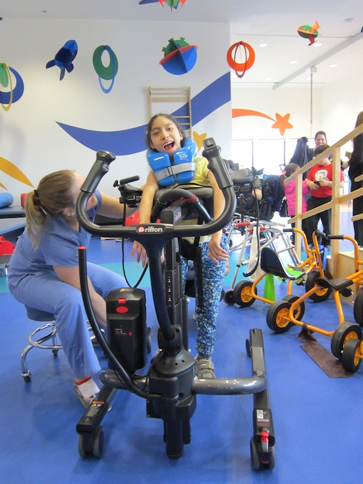 Sofia Vazquez, 10, is learning to walk aided by a gait trainer and physical therapist, Melody Zisman. Sofia was born at 34 weeks when her mom was in a car accident that forced physicians to deliver the baby early.