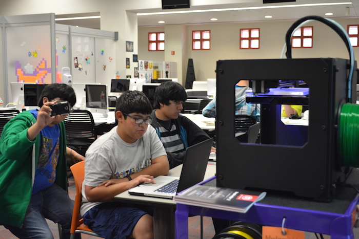 Teens learn to use a 3D printer during Teen Tech Week at the San Antonio Public Library. Photo Courtesy of Teen Services at the San Antonio Public Library.