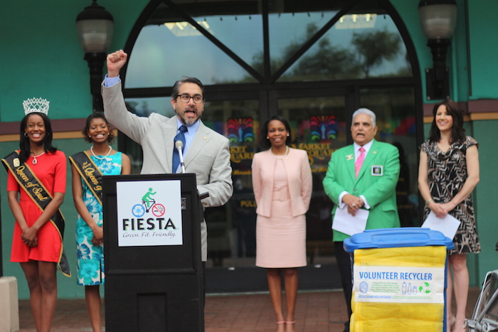 """Councilmember Roberto Treviño (D1) shouts """"¡Viva Fiesta! """"after giving a speech about keeping Fiesta green, fit, and friendly. Photo by Joan Vinson."""