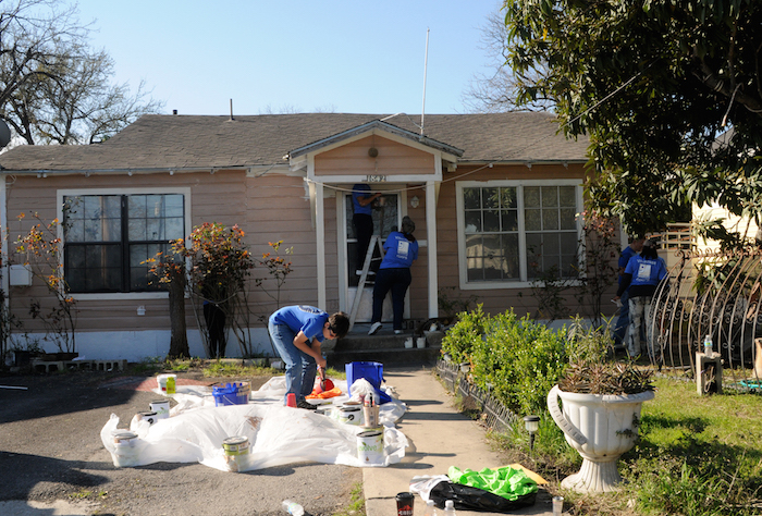 Volunteers start work early at various homes during the EastPoint Shine Paint-A-Thon. Photo by Kristian Jaime.