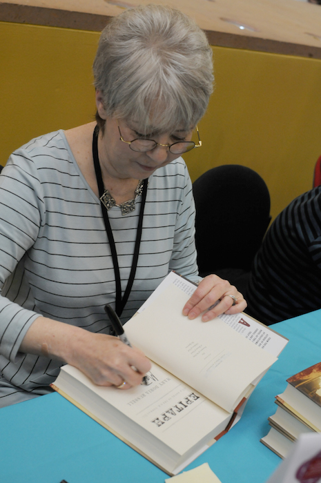 Author Mary Doria Russell signs copies of her book at the San Antonio book festival held at the Central Library downtown. Photo by Kristian Jaime.