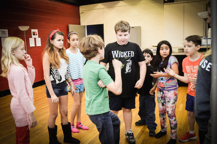Students practice their improvisation skills with Miss Courtnie. Photo by Andrea Medina.