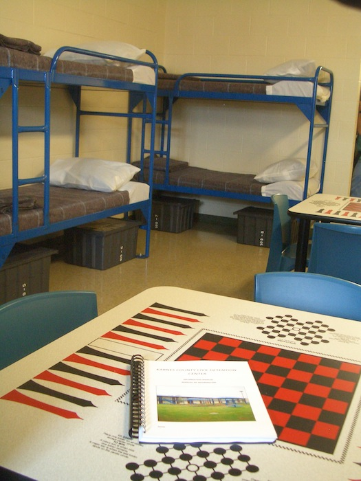 Checkerboard in dorm room with bunks at Karnes on opening day, 2012. Photo by Lily Casura.