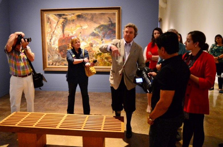 """Wyeth discusses his technique with """"Inferno, Mohegan"""" in the background. Photo by Page Graham."""