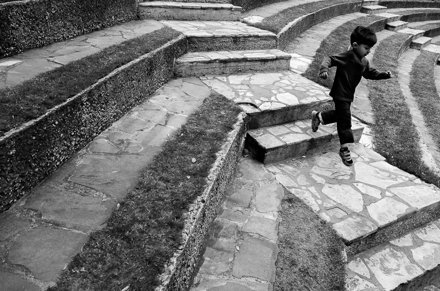 A child runs down the stairs at the Arneson River Theatre. Photo by Scott Ball.
