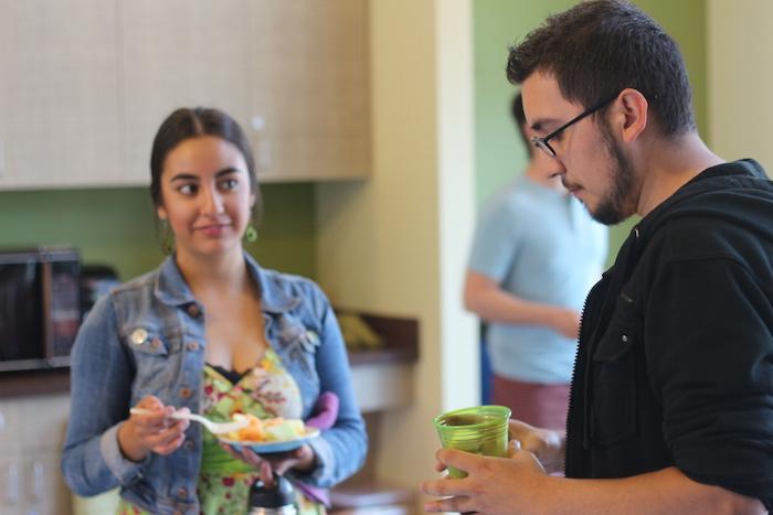 "Lisa Cervantes enjoys refreshments during EcoCentro's ""bEARTHday"" celebration. Photo by Joan Vinson."