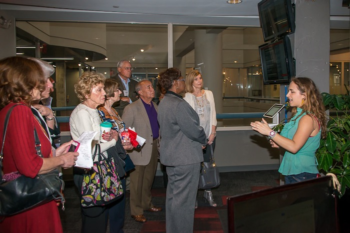 Camille Seyler of Geekdom leads MLP alumni on a tour of the facility in the Rand Building. Courtesy photo.