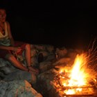 Julio tells stories by the fire in Guatemala. Photo by Everett Redus.