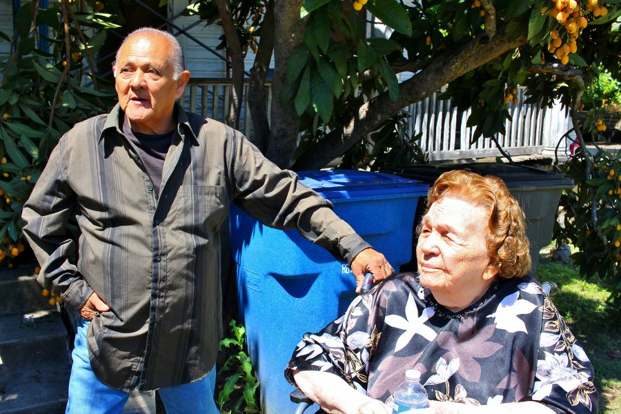 Miguel Calzada (left) and Marylou Miller look on as the Save Miguel's Home Team gathers in support. Photo by Page Graham.
