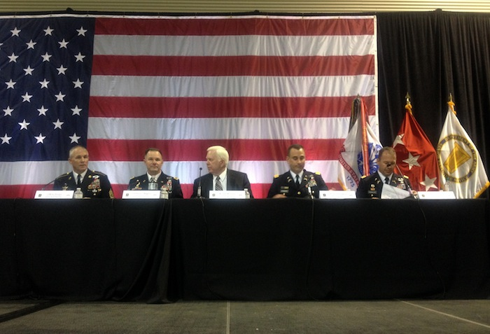 "Army and Pentagon representatives speak and listen during the Army's ""listening session."" Photo by Lily Casura."