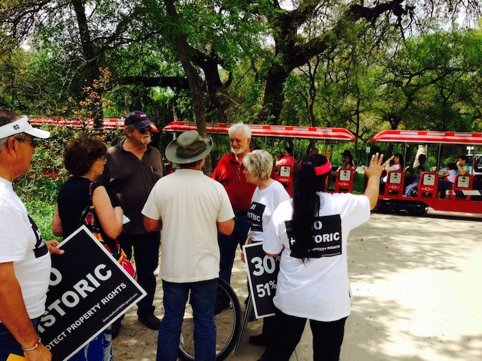 Members of Coalition to Protect Property Rights gather March 22 in Brackenridge Park to declare opposition to a new application process for a historic district designation in Mahncke Park. Courtesy image.