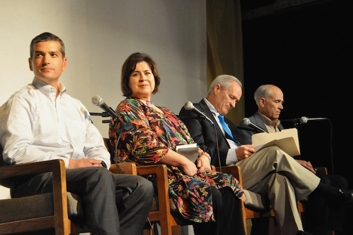 Mayoral candidates Mike Villarreal, Leticia Van de Putte, Tommy Adkisson, and Rhett Rosenquest Smith listen to questions during the Esperanza Peace & Justice Center's mayoral forum. Photo by Iris Dimmick.