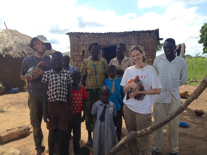 Chandler and her film partner stand with a family in Odek village. Courtesy photo.