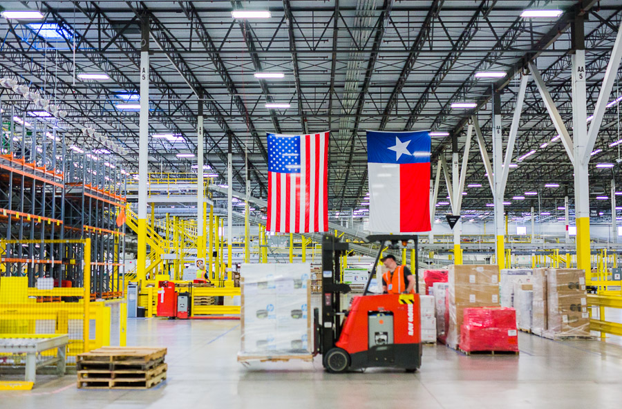 A forklift operator moves palettes at the Amazon Fulfillment Center in Schertz.