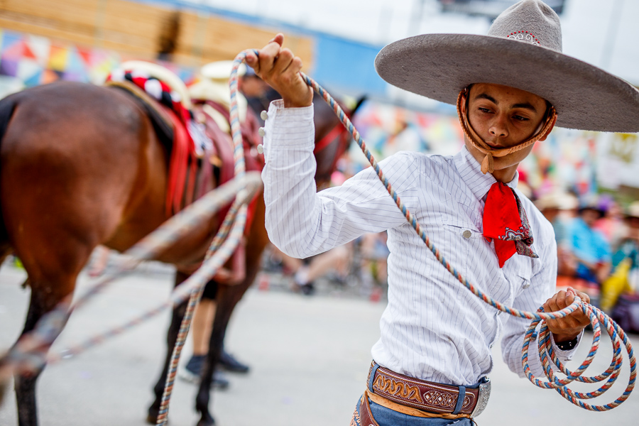 A charro performs a trick with his lasso during the 2015 Battle of Flowers Parade in downtown San Antonio. Photo by Scott Ball.