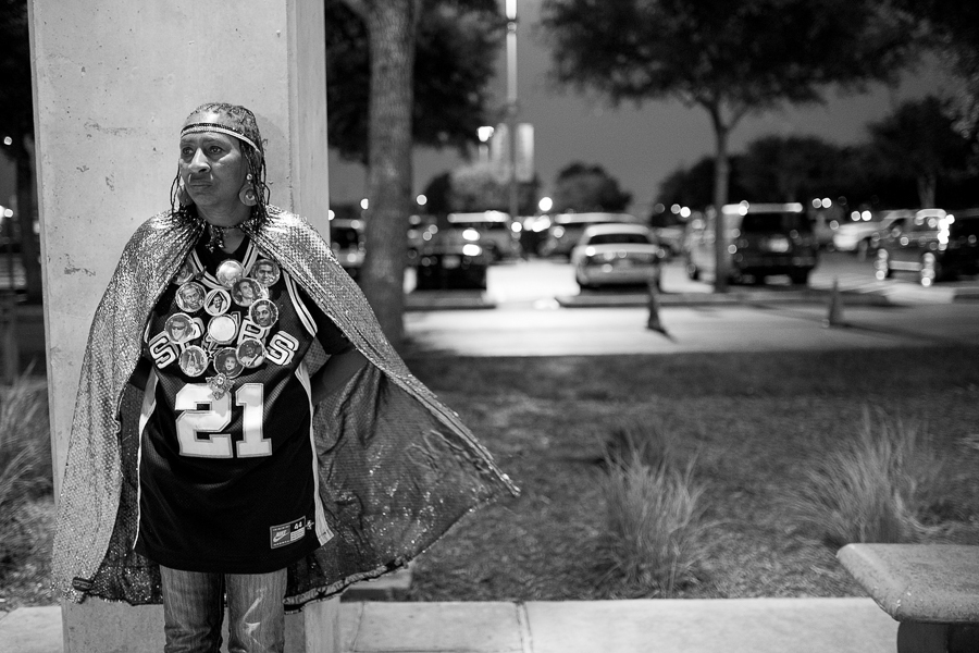 Earline Miller looking discouraged after learning The Spurs were down in the fourth quarter. Photo by Scott Ball.