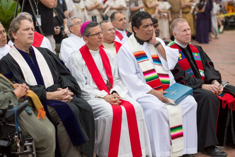 Archbishop Gustavo García-Siller (second from left) during the 2015 reenactment of the Crucifixion of Jesus in Milam Park. Photo by Scott Ball.