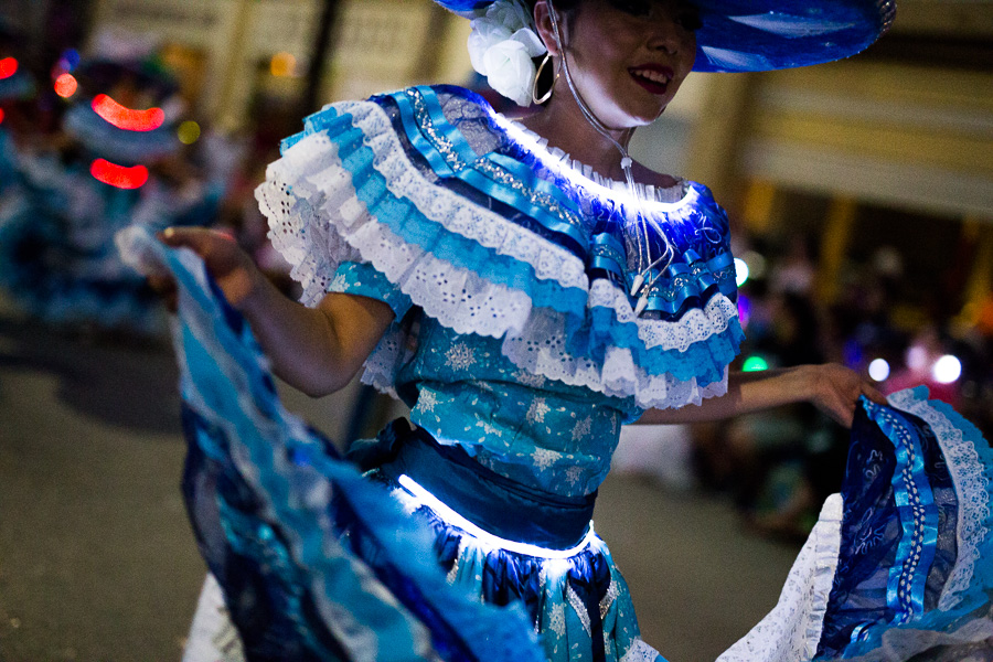A folklórico dancer during the Fiesta Flambeau Parade in downtown San Antonio. Photo by Scott Ball.