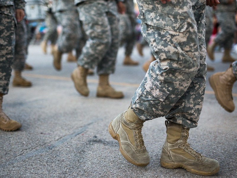 The United States Army marches during the Fiesta Flambeau Parade in downtown San Antonio. Photo by Scott Ball.