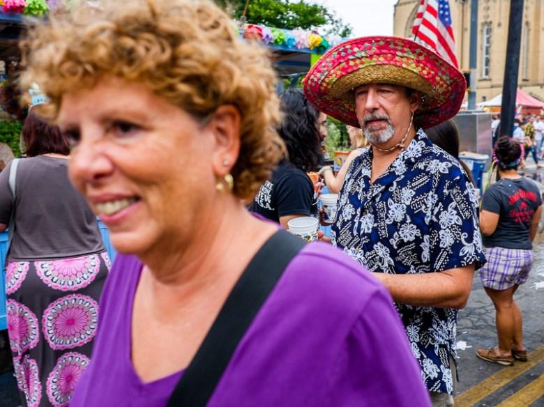A couple walks by during NIOSA at La Villita.  Photo by Scott Ball.