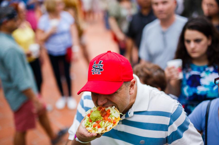 A man eats a chalupa during NIOSA 2015 at La Villita. Photo by Scott Ball.