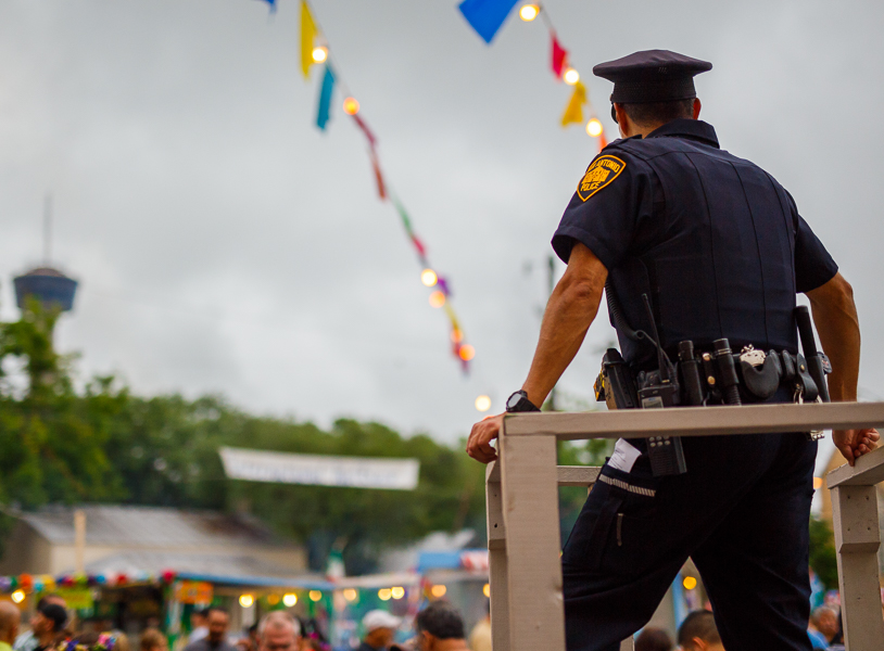 A police officer perched high above the crowd during NIOSA 2015 at La Villita. Photo by Scott Ball.