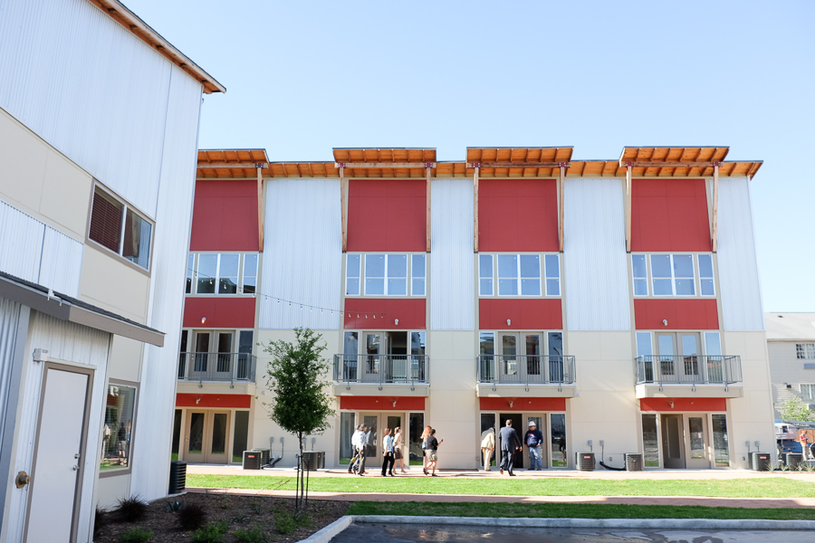 A tour group is guided through the complex at The Peanut Factory Lofts Ribbon Cutting. Photo by Scott Ball.