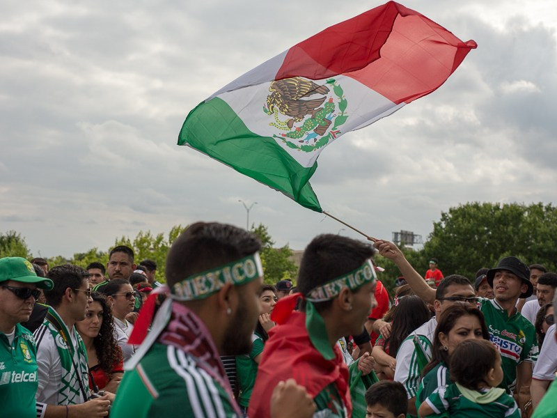 A Mexican flag is waved at the USA vs Mexico friendly match at the Alamodome. Photo by Scott Ball.