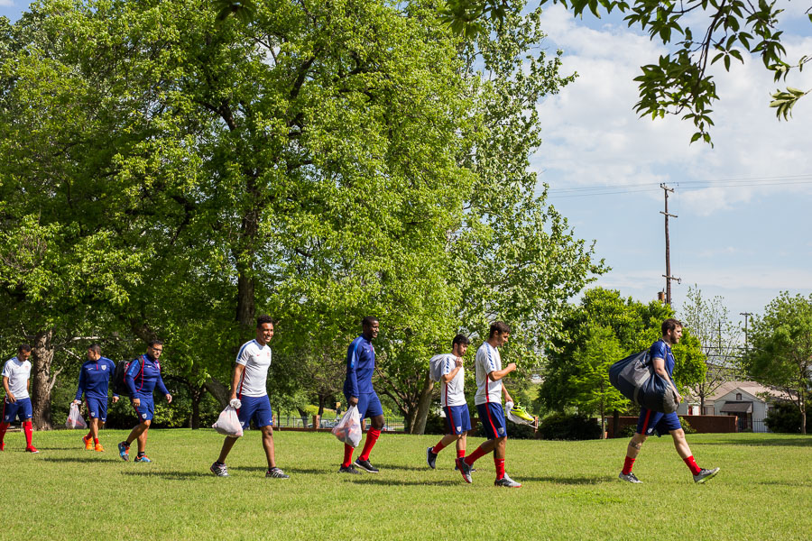 The USMNT walks onto the soccer field at a practice hosted by Trinity University. Photo by Scott Ball.