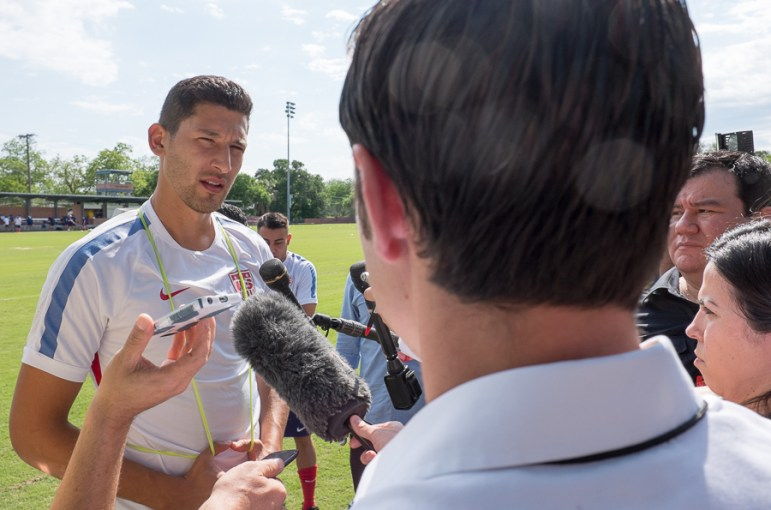 United States Soccer player Omar Gonzalez speaks with press at a practice hosted by Trinity University. Photo by Scott Ball.