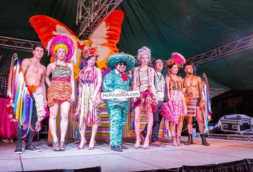 A fashion show designed by Agosto Cuellar poses for a photograph during WEBB Party ¡Ultima Fiesta! at the Lambermont Estate.