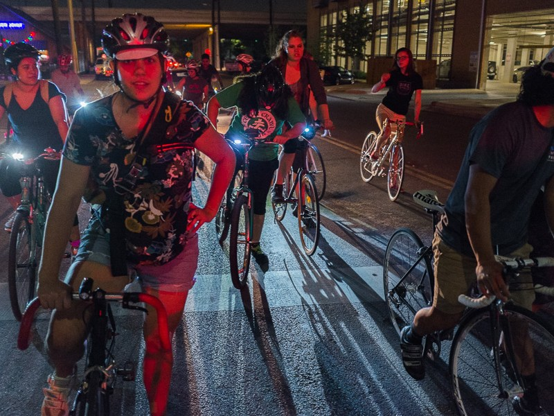 A group ride concludes Women's Wrench Night at the corner of Josephine and Broadway in midtown San Antonio. Photo by Scott Ball.