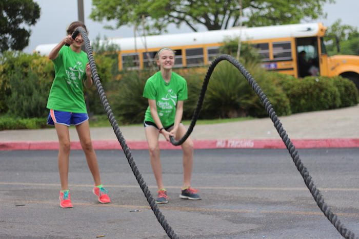 Two Alamo Heights Junior School students exercise using a rope during the Heights Health Expo on Thursday. Photo by Joan Vinson.