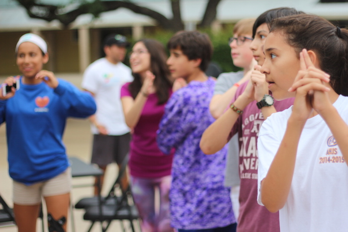 """A group of students play the game, """"Just Dance"""" in the Alamo Heights Junior School courtyard. Photo by Joan Vinson."""