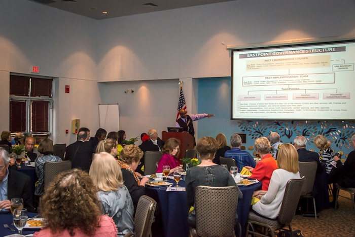Anthony Leverett walks the tour group through the Promise Zone organization and early results. Courtesy photo.