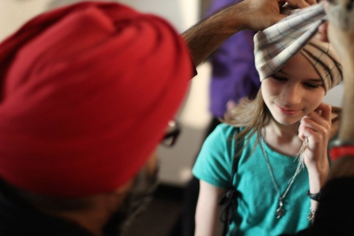 A girl receives a turban during the 2015 Asian Festival. Courtesy of Sikh Dharamsal.