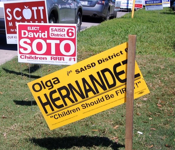 District 6 candidates signs found outside Thomas Edison High School during Early Elections in San Antonio. Photo by Lea Thompson