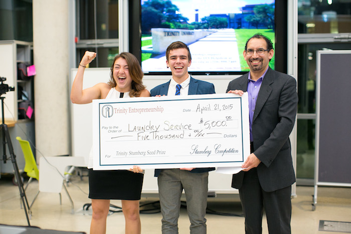 Michaela Hoffman and Edwin Manton, both freshmen, receiving their $5000 prize for their startup Laundry Service for Colleges. Photo Courtesy of Anh-Viet Dinh.