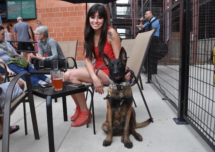 Melanie Ramirez and Heidi, a Dutch shepherd, enjoy the GS1221 patio with friends. Photo by Iris Dimmick.