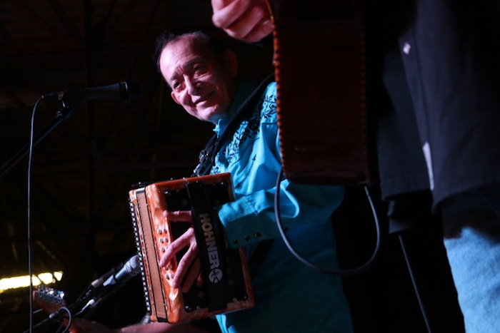 Flaco Jiménez smiles on stage. Photo by Amanda Lozano.