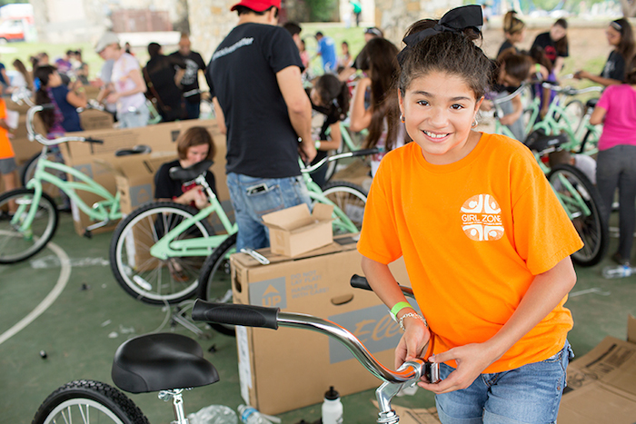 Gia, 9, assembles a bike during the Chiquitas Ciclistas event in the Eastside. Photo by Rachel Chaney