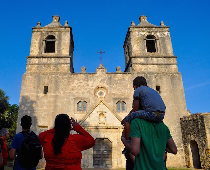 A family admires Mission Concepción. Photo by Iris Dimmick.