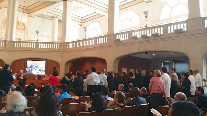 RK Group staff members stand for recognition in City Council Chambers. Photo by Iris Dimmick.