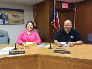 SAISD Board Secretary Debra Guerrero and member Ed Garza take their new chairs. Photo by Robert Rivard.