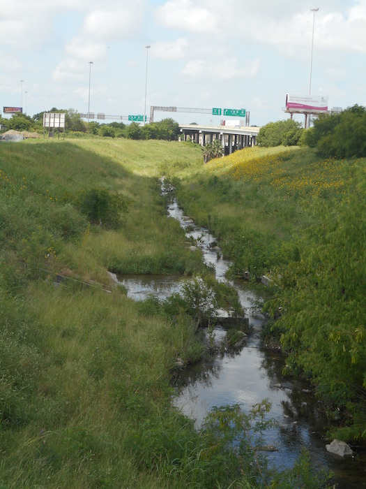 The San Pedro Creek flows towards IH-35, just a few blocks from St. Henry Catholic Church. Photo by Don Mathis.