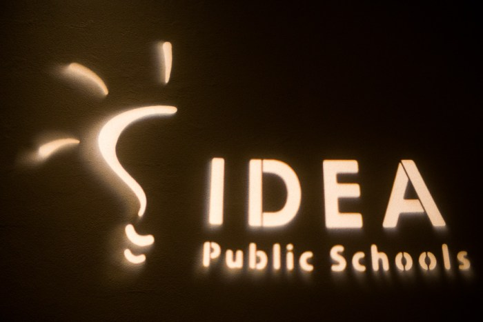 The Idea Public Schools logo is displayed on the walls during the IDEA Public Schools luncheon. Photo by Scott Ball.