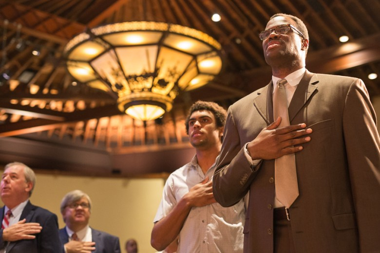 David Robinson stands for the pledge of allegiance during the IDEA Public Schools luncheon. Photo by Scott Ball.